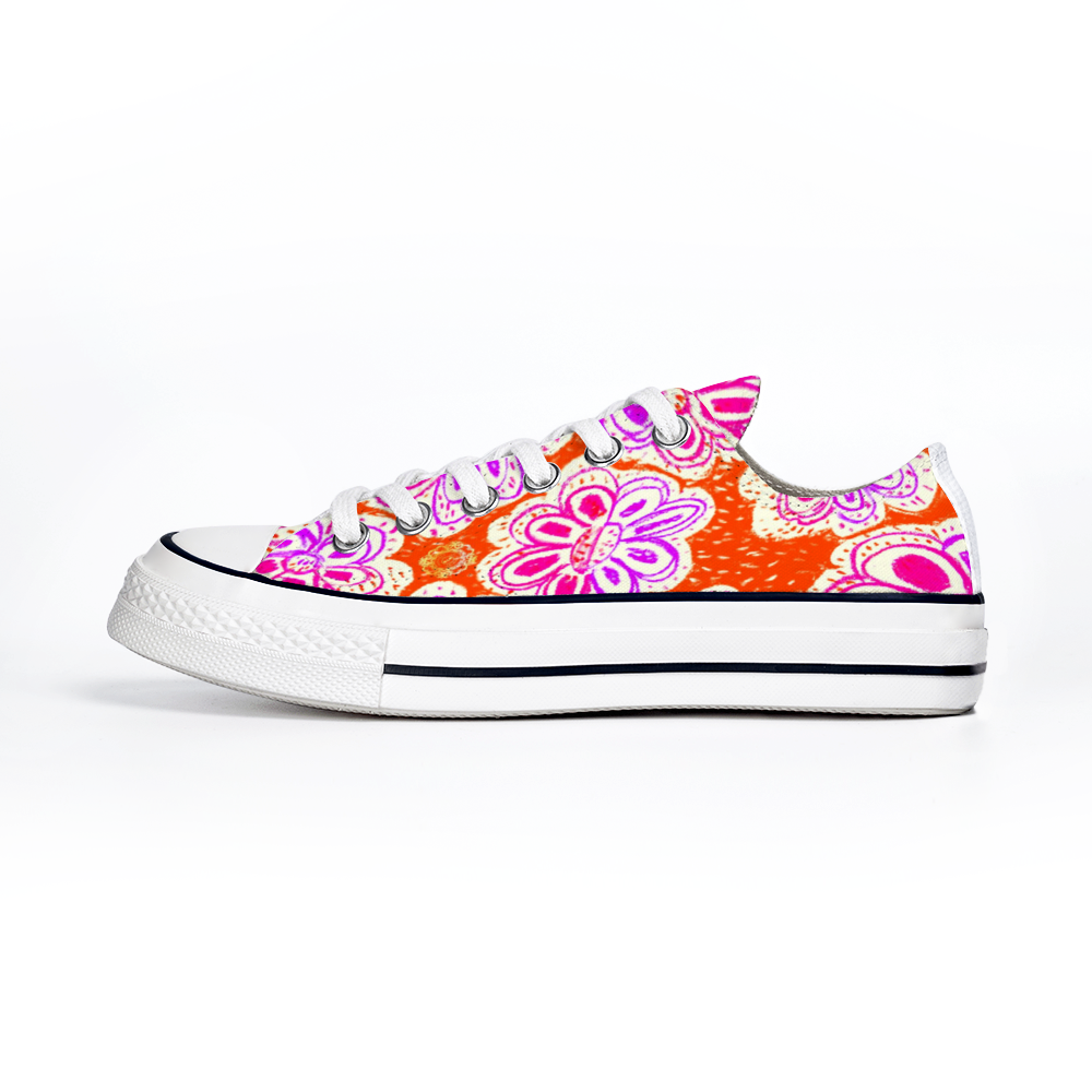 San Flor Collection: Unisex pink floral shoes with an orange background.