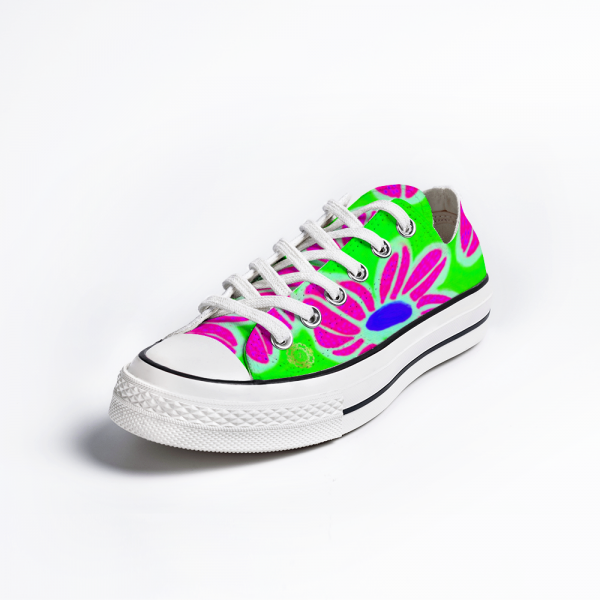 San Flor Collection: Womens vibrant pink floral shoes with a green background.